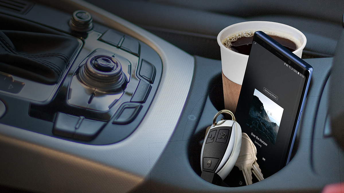 a cup of coffee sitting on top of a car